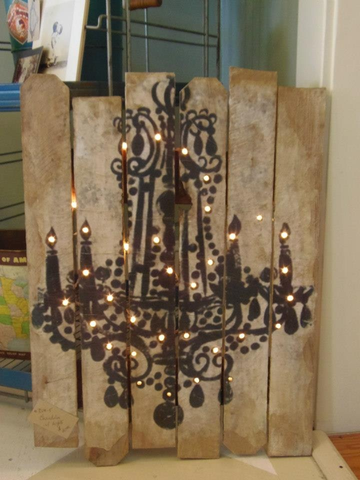 From Crooked Creek Farms.  This is a clever use of a chandelier stencil, lights and wood planks.