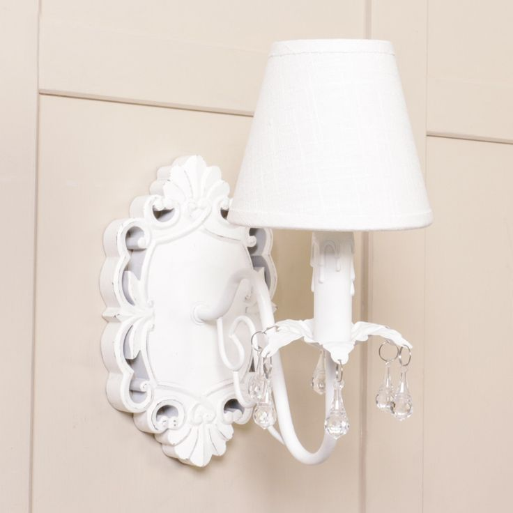 Elegant french style wall light with a wooden carved plaque linen shade and acrylic crystal effect