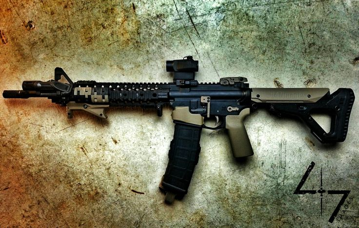 Dissipator with aimpoint micro, umbrella corporation grip, UBR stock, 40 round pmag, strike industries angled grip