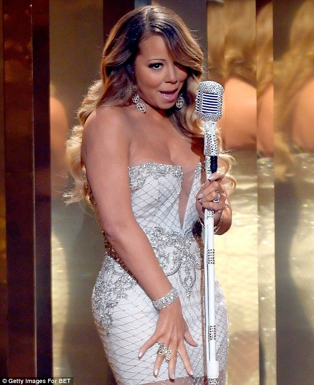 Matching: Mariah performed with a glittering microphone