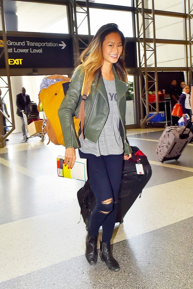 Jamie Chung wears a simple moto jacket + graphic tee + ripped jeans to the airport