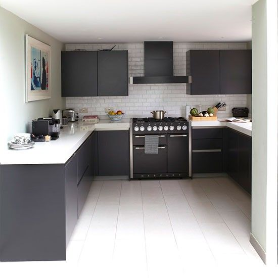The range cooker was the inspiration behind the monochrome theme in this spacious U-shaped kitchen.   Kitchen units  Such Designs