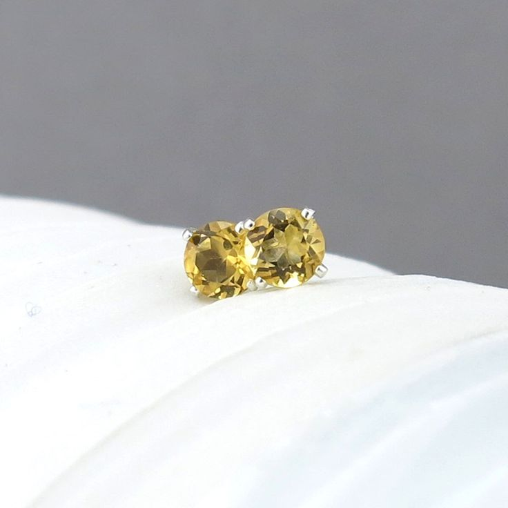 Citrine Earrings Tiny Silver Earrings Citrine Stud Earrings November Birthstone Gemstone Post Earrings Silver Stud Earrings 4mm by JenniferCasady on Etsy https://www.etsy.com/listing/116657344/citrine-earrings-tiny-silver-earrings