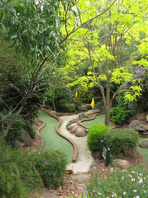 Miniature golf course....like the layout, but would replace golf bits with flower beds!