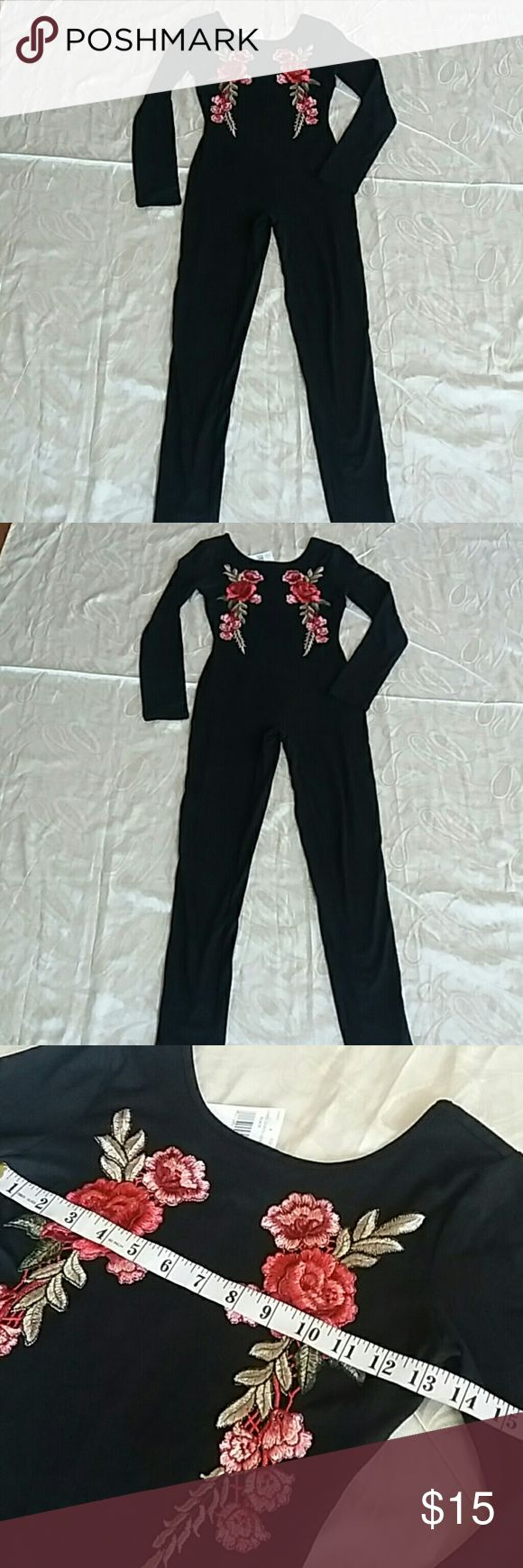 NWT black catsuit Size small stretch black catsuit with floral design on chest and scoop front and back. New with tags. love J Pants Jumpsuits & Rompers