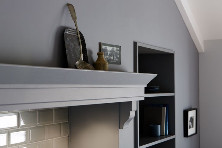 The beauty is in the detail - The addition of bespoke elements such as this mantelpiece brings classic style to your shaker kitchen. The Shaker Collection by Howdens Joinery.