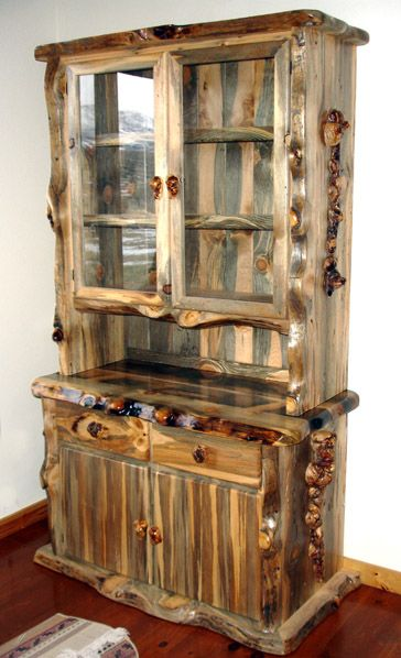 Blue Pine Hutch with Lodge Pole Burl Accents. Looks like a husband and wife team, they also do custom knives. http://www.greatbasinart.com/juniper-blue-pine-furniture-gallery.html