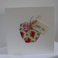 A handmade card to give thanks to your child's teacher. Each card is individually made and hand sewn from high quality fabric. This card can be personalised with a name on the tad if required, such as Thank You Miss Clarke. The card measures approxima...
