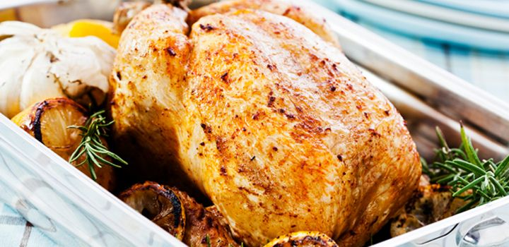Roast chicken with bread and cashew nut stuffing and roast vegetables.