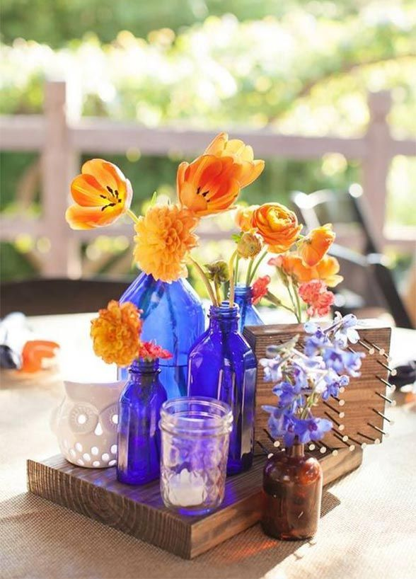 Floral Arrangements For A Modern Feel, Try Placing Single Flowers In A  Variety Of Vases. Alternate The Size Or Color Of The Flowers And Vases For  An ...
