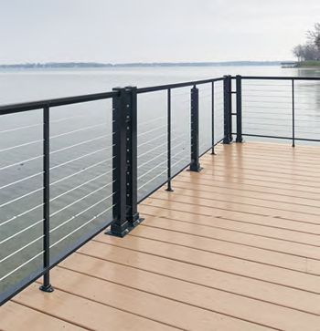 Cable Deck Railing Aluminum See 100s of Deck Railing Ideas http://awoodrailing.com/2014/11/16/100s-of-deck-railing-ideas-designs/