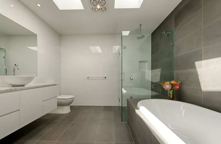 This Marryatville bathroom has beautiful bluestone tiles ...