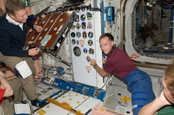 Completing a tradition that dates back more than 30 space shuttle missions, the four astronauts flying on NASA's final shuttle flight added their insignia to several of the walls aboard the International Space Station before leaving the orbiting laboratory Tuesday for the final time.