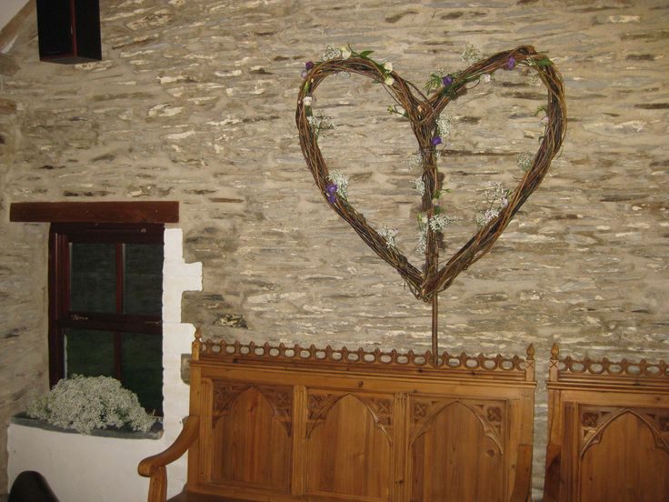 Willow heart, decorated with gypsophilia and Lisianthus, in place at wedding venue, Jabajak vineyard  Restaurant with rooms, Llanboidy, Carmarthenshire.