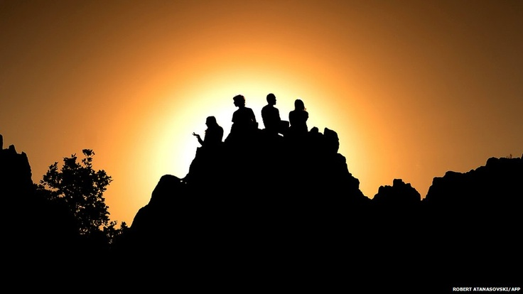 A group of people greet the dawn of the summer solstice at the megalithic observatory Kokino. The ancient astronomic observatory in Macedonia dates back more than 4,000 years.