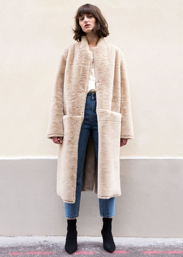 "Fully Reversible, Faux Fur Shearling Coat. 2 Patch Pockets  High Back Slit Detail. Front Hook Fastening  90% Polyester, 10% Wool 43"" Length,17"" Shoulder, 40"" Bust Dry Clean Imported"