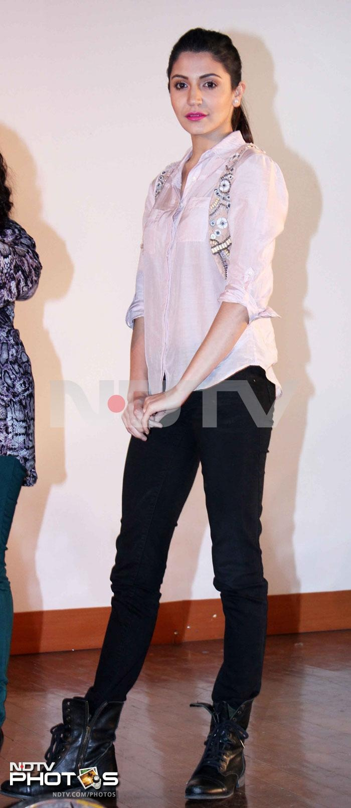 Anushka Sharma was casual chic in a pink shirt and black denims. Pink lips and a ponytail completed her look.