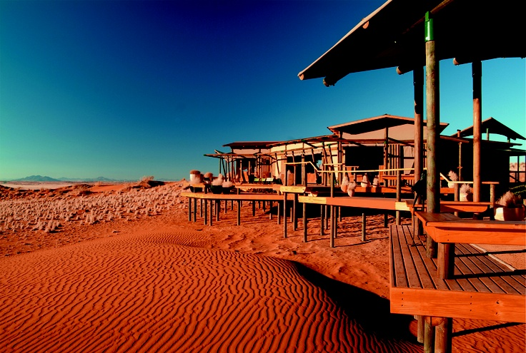 The lodge is built on stilts on top of a dune plateau