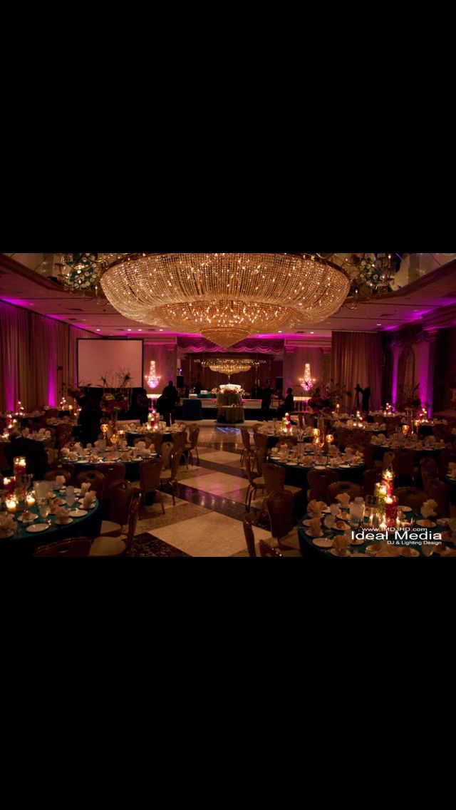 Hot Pink Uplighting and a monogram at
