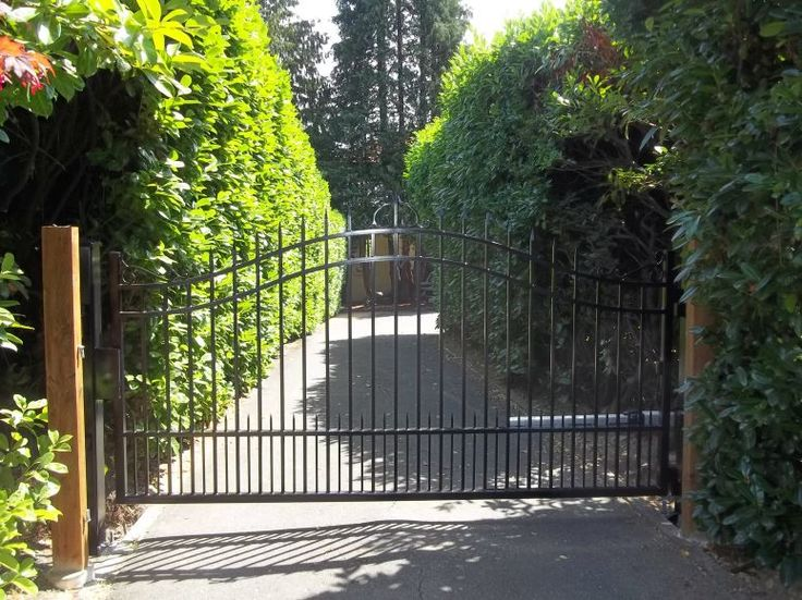 73 best custom residential iron gates by automated gates for Single wooden driveway gates
