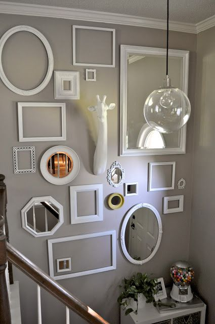 Anna styles a fab white and grey focal wall with Z Gallerie's fauxidermy Giraffe Head.