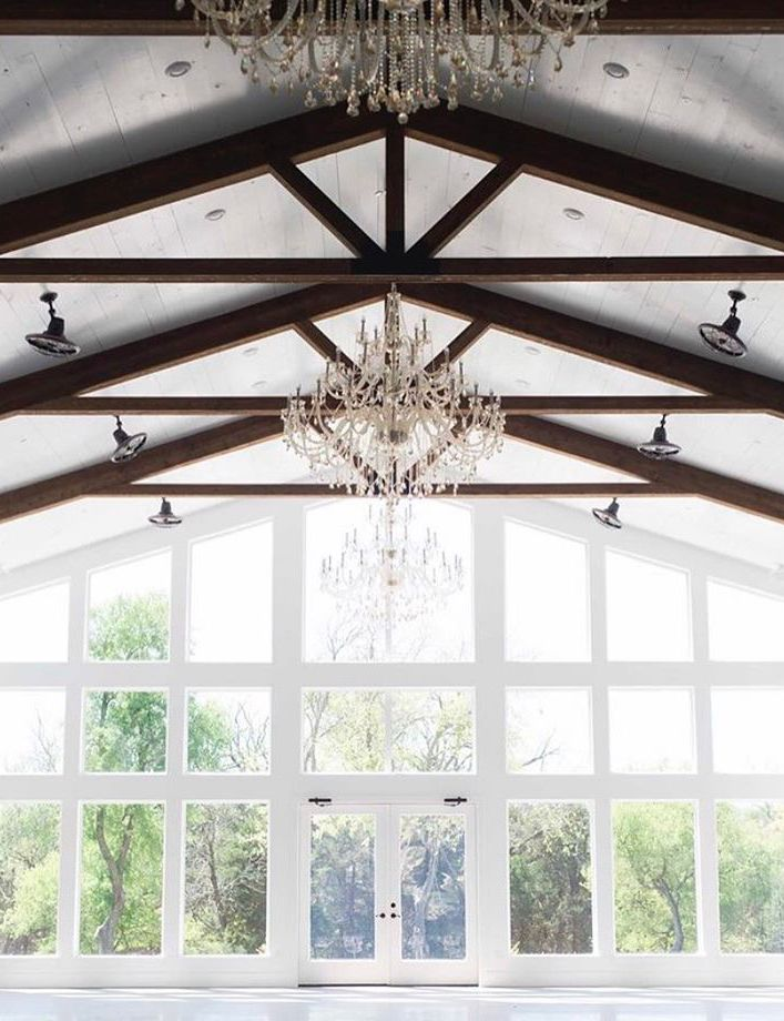 Firefly Gardens is a new wedding venue in Dallas Fort Worth is perfect for a modern barn wedding.  Just look at the white walls, wood beams, and chandeliers!