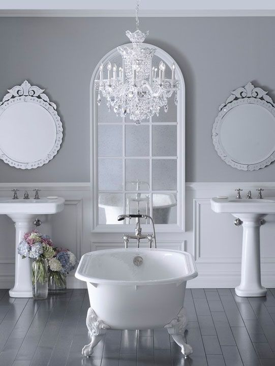A freestanding bathtub in the centre of a room will create a luxury, spa feel. Add large mirrors and a chandelier to complete the look