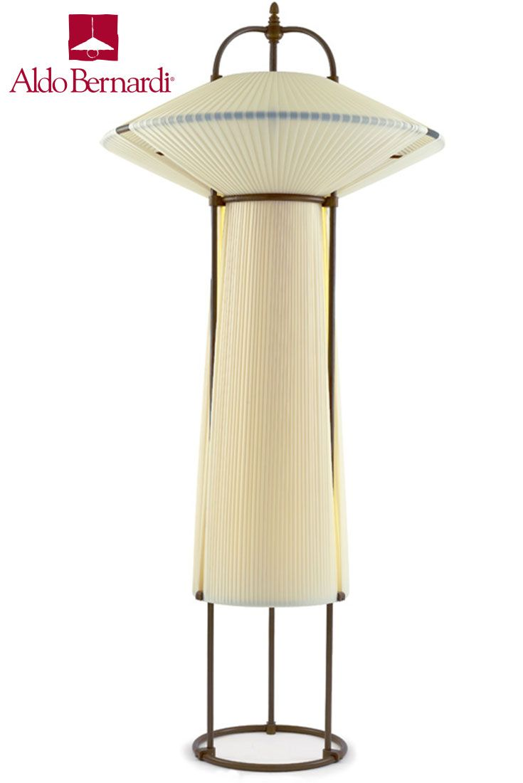 Aldo Bernardi Nunui is a triple stems antique brass mobile lighting fixture on round base with four lights and fabric shade fully integrated into structure.
