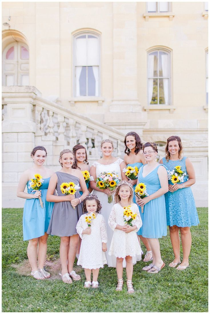 Bridesmaid inspiration. Light blue mix-matched dresses with sunflower bouquets. Central Illinois church wedding in Carlinville, IL.