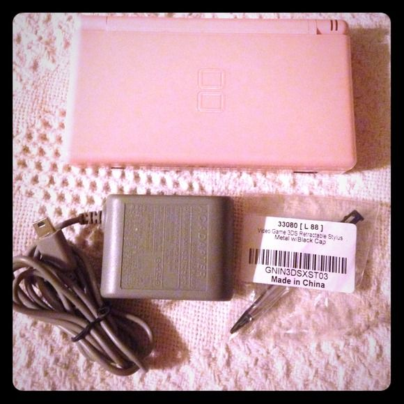 Rose Pink Nintendo DS 🌟REDUCED🌟This Nintendo DS Lite is in great shape apart from the couple of scratches on the top screen as you can see in the last image. I just brought a brand new charger and stylus for it as you can see in the first image. It is in great shape and I will be glad to bundle my three games (Nintendogs, Finding Nemo and Monster House) for a great price. Price is pretty negotiable. Nintendo Other