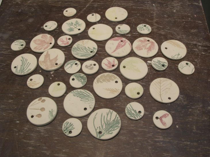 Ceramic nature-inspired ornaments in the studio. Awaiting the finishing clear glaze and final firing.  --Guild of Thing Smiths
