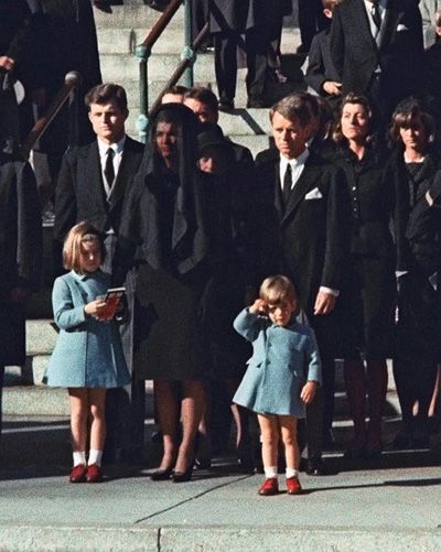 Three-year-old John F. Kennedy Jr. salutes his father's casket  in Washington on Nov. 25, 1963, three days after the president  was assassinated in Dallas. His widow Jacqueline Kennedy (center)  and daughter Caroline were accompanied by the late president's  brothers Edward and Robert.