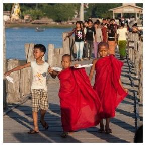Young monks crossing U Bein's Bridge, Myanmar
