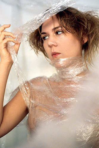 nude female wrapped in plastic