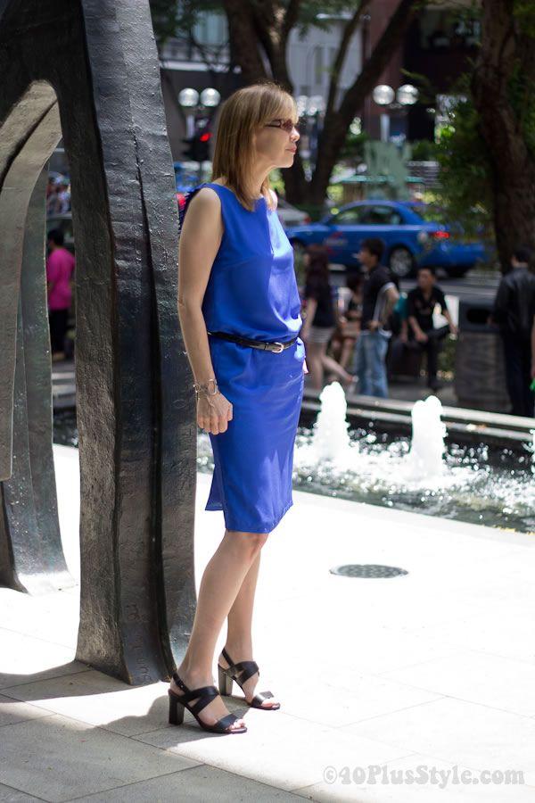 Wearing a bright blue dress from Dresstronomy