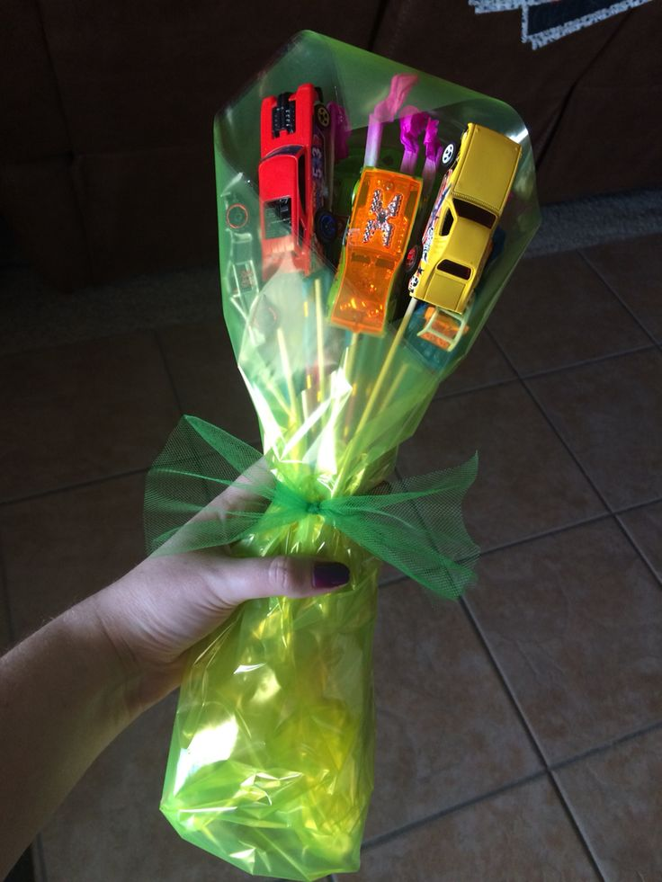 A car bouquet made for boys of toy cars and sparklers. Perfect for when little girls get flower bouquets for a gymnastics performance or dance recital, boys can get this!
