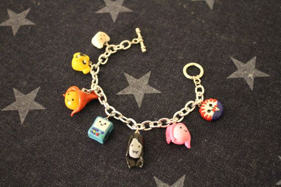 Hand sculpted Adventure Time charm bracelet. Charcters can be added or swapped out. Available in my Etsy shop :)