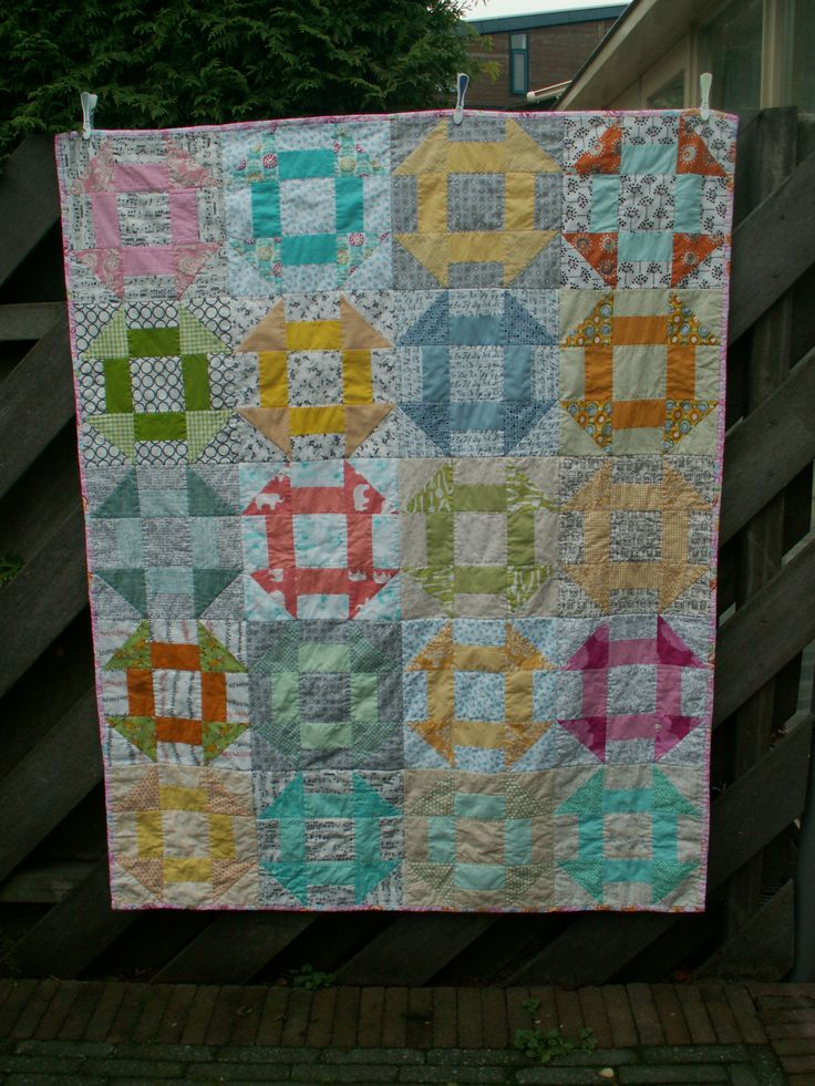 This quilt is made for the Comfort do.Good circle on Flickr. I was the quilter for September and I chose the Churn Dash as the block. The other 9 members all made 2 blocks and I put it together. The quilt will be donated to charity :-)