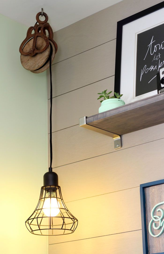 Target pendant light hard wired suspended from a vintage pully