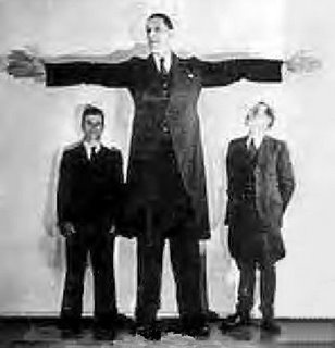 Vaino Myllyrinne (1909-1963, Finland).  He is the 4th tallest man in history and the tallest man in the world during his lifetime at 8'3''.  He was also the tallest soldier, husband, and father.  He has the record for longest hands at 15.7 inches.  He was 7'3'' when he was 21 and in the army, but had a growth spurt in his late 30s from his acromegaly condition and grew another foot.  He is rare among giants in that he walked freely and unassisted until almost the end of his life.