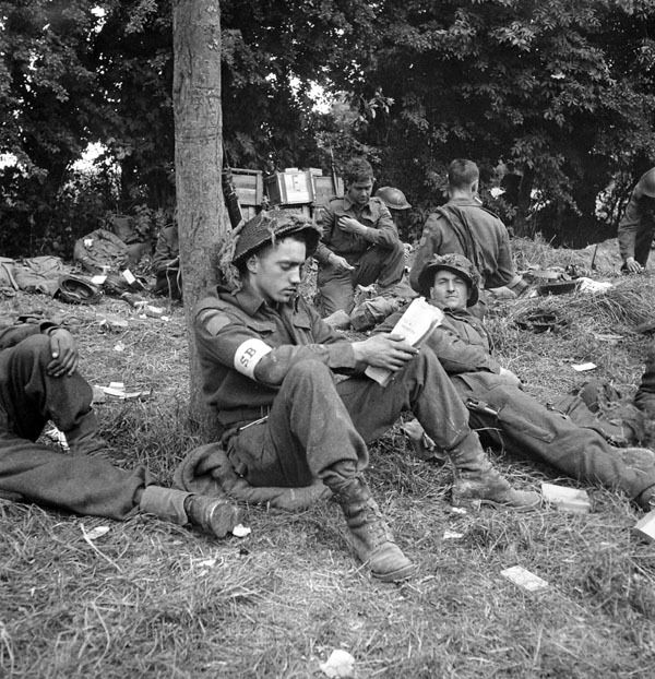 Stretcher bearer of an unidentified regiment of the 9th Canadian Infantry Brigade in the Normandy bridgehead, ca. 8-9 June 1944. Photographer: Frank L. Dubervill