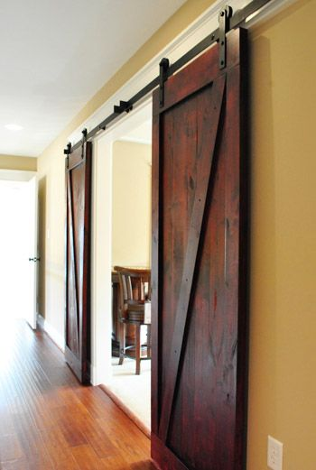 Much more slick than pocket doors - Sliding barn doors