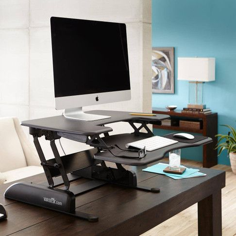 Height Adjustable Standing Desks Varidesk Sit To Stand