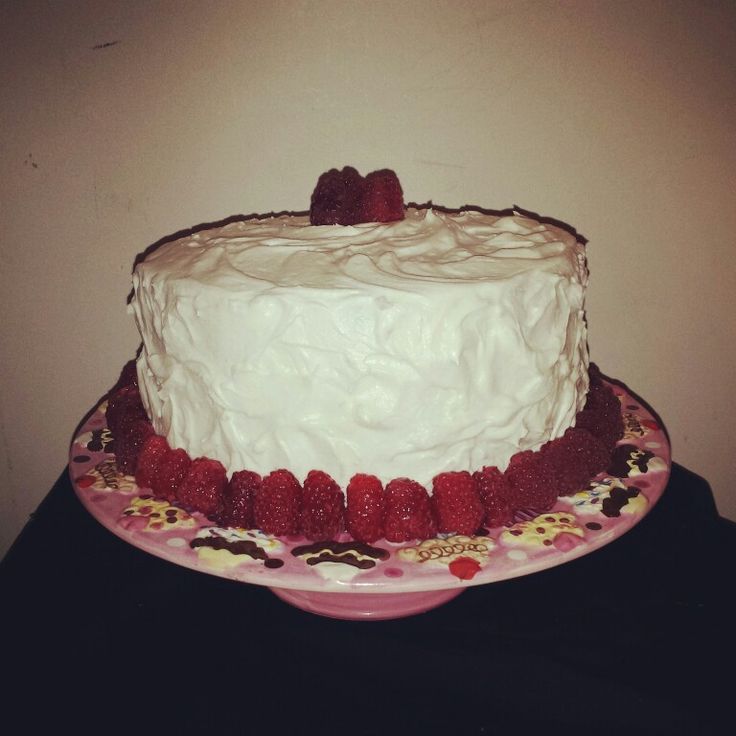 Lemon infused  cake with raspberry filling fluffy cream cheese frosting and fresh raspberries!