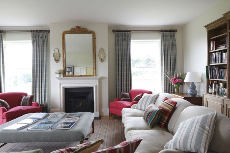 Sitting room | Large windows looking out to the garden and pair of mirrored, giltwood wall lights either side of the mirror. Large bookcase on the right hand wall, bought from Bath antiques fair.