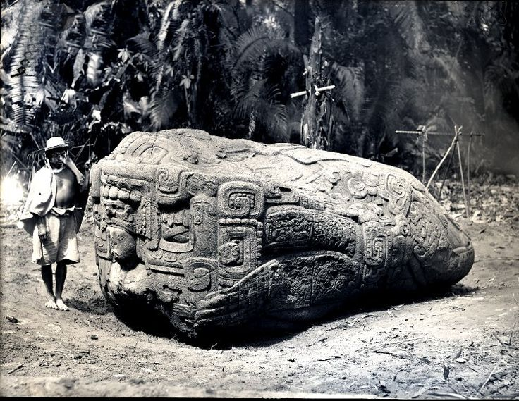 Zoomorph B, man standing next to monolithic animal, south face, near the eastern border of the Great Plaza. Quiriguá, Guatemala. Photographed by Dr Alfred Percival Maudslay in 1894. -British Museum-