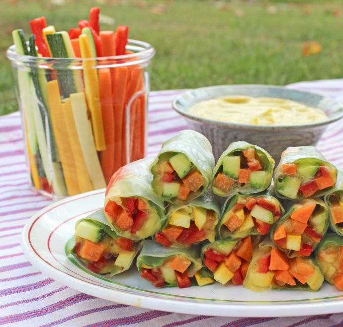 Fresh Spring Rolls with Mango Dipping SauceServes 2 10 rice paper rolls For the Dipping Sauce: - 1 mango - 1 avocado - 1/2 a small jalapeño pepper For the Fillings: - 1 large carrot - 1 red pepper - 1 zucchini - spinach leaves