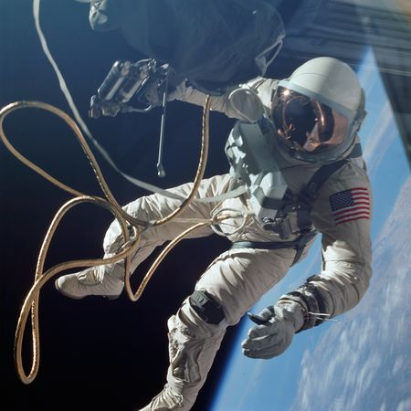 Tethered to a spacecraft by cords wrapped in gold tape, astronaut Edward H. White floats over New Mexico during the Gemini 4 mission in June 1965—the first U.S. mission to include a spacewalk.