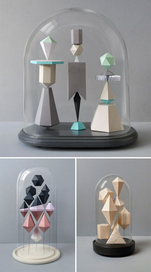 white geo paper shapes would be great breaking up the tablescape attached to white sticks at different heights