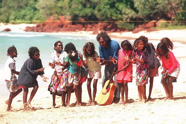 Aboriginal Educator, Musician & Ambassador Dr Mandawuy Yunupingu - born in Arnhem Land, was the first aboriginal in the NT to gain a Bachelor of Education & subsequently became the first Indigenous Australian to be appointed a school principal. He developed a progressive curriculum that incorporated both Western & Aboriginal knowledge traditions.